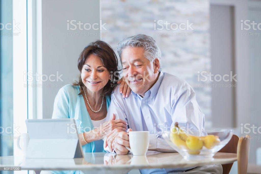 Senior couple using a digital tablet stock photo