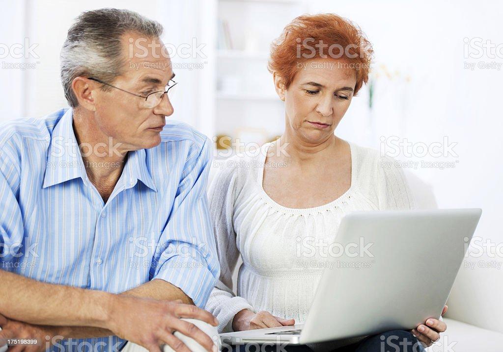 Senior couple using a laptop. royalty-free stock photo