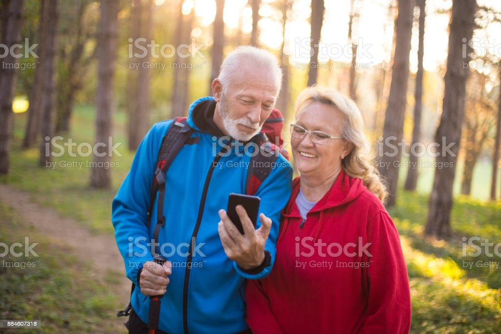 Senior couple using a mobile phone stock photo
