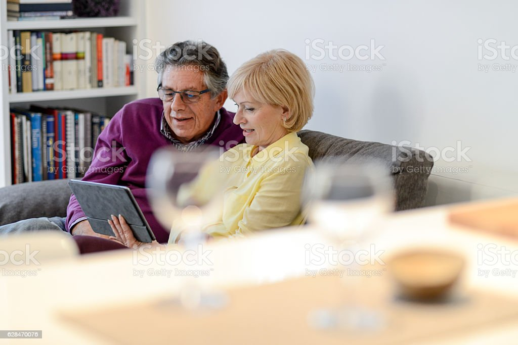 Senior couple using digital tablet stock photo