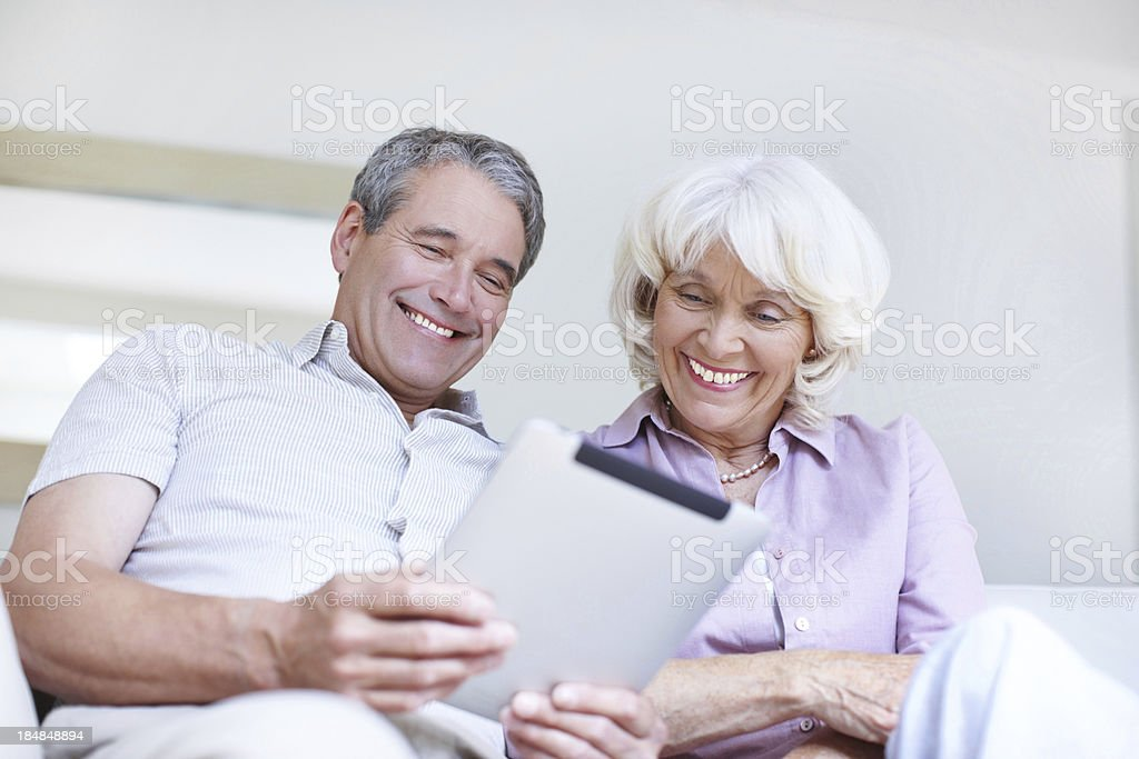 Senior couple using digital tablet together royalty-free stock photo