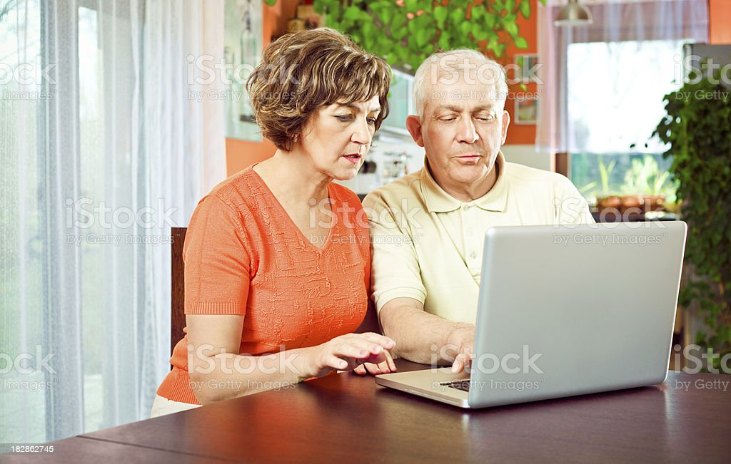 Senior couple using laptop royalty-free stock photo