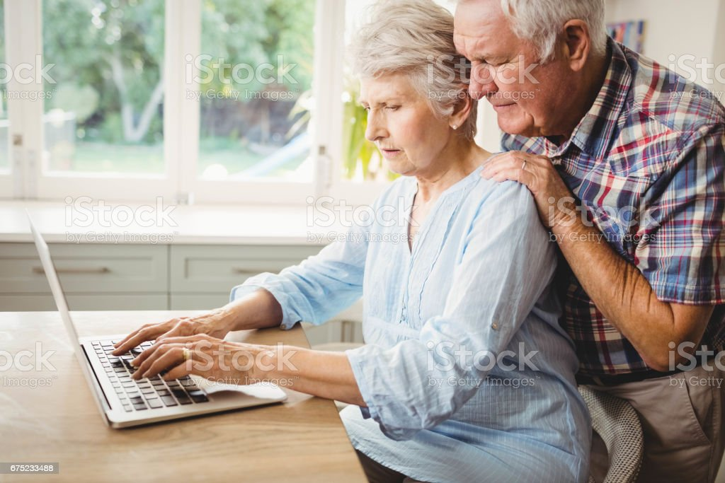 Senior couple using laptop royalty-free stock photo
