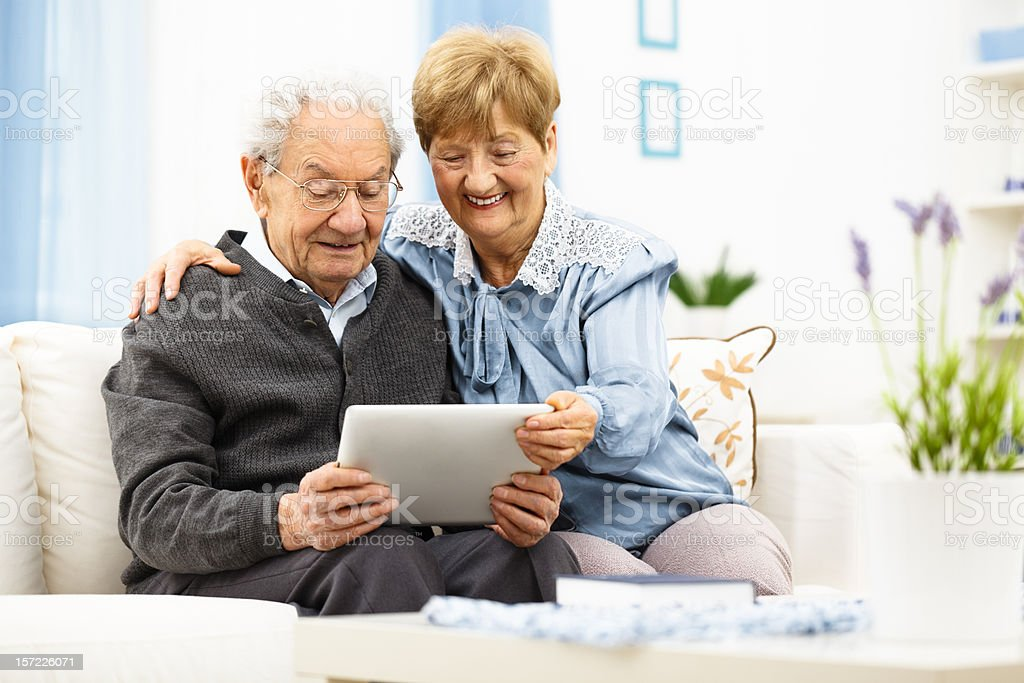 Senior couple using together a digital tablet royalty-free stock photo