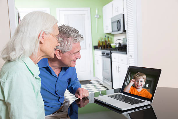 Senior Couple Video Chatting with Grandchild stock photo