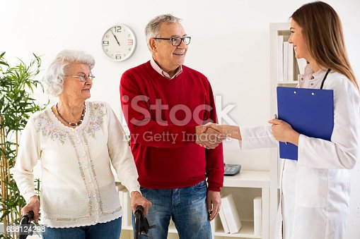 istock Senior couple visit doctor about medic consultation 638124298