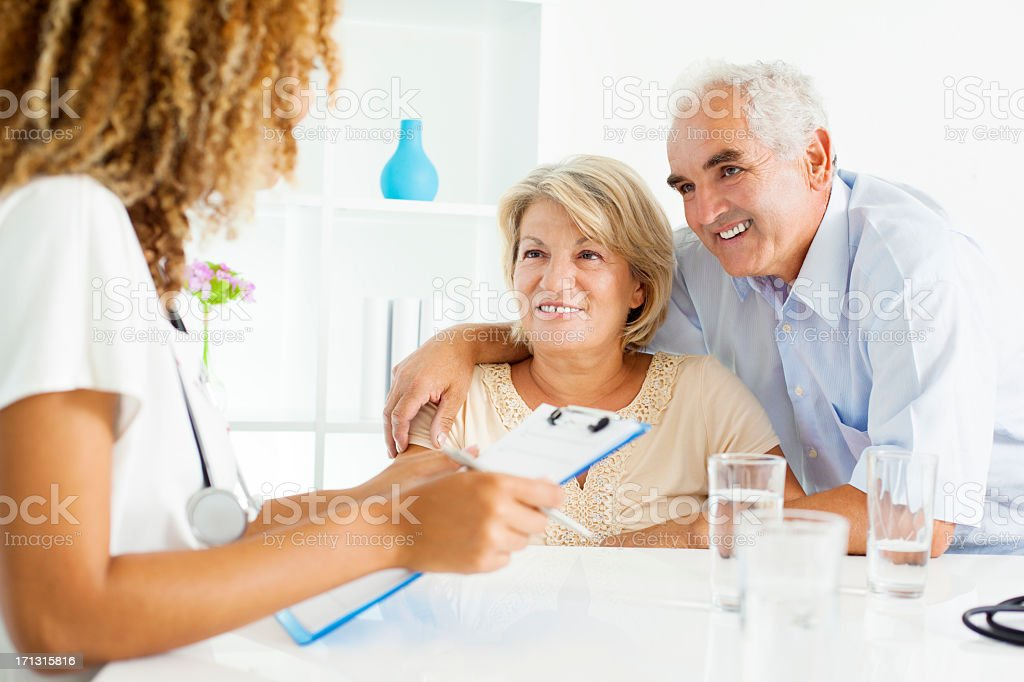Senior Couple Visit Doctors Office royalty-free stock photo