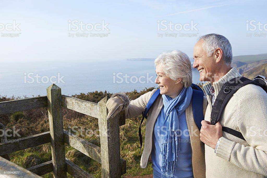 Senior Couple Walking Along Coastal Path stock photo