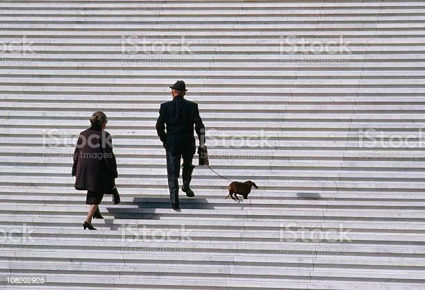Senior couple walking dachshund dog up stairs picture id108202925?b=1&k=6&m=108202925&s=612x612&h=59rjqtna z4wif3rc37crckvoiiwm9bx77bhjesvxp0=