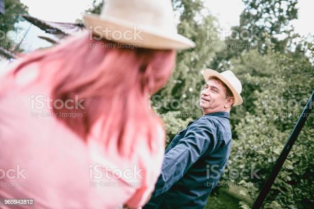 Senior Couple Walking Holding Hands In Nature - Fotografias de stock e mais imagens de Adulto