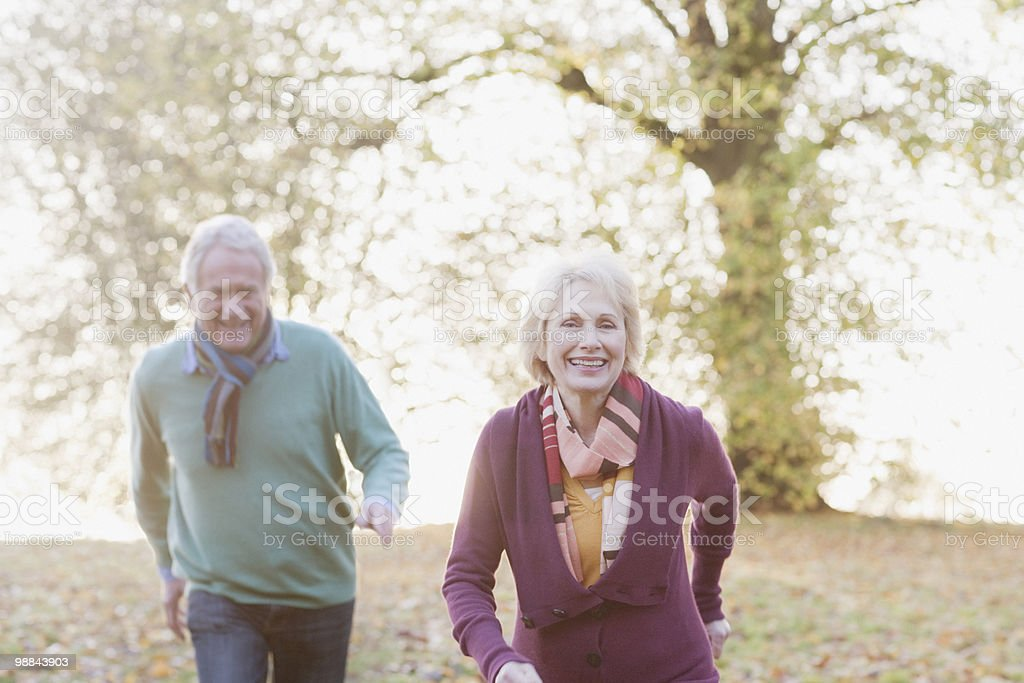 Senior couple walking in park royalty-free stock photo