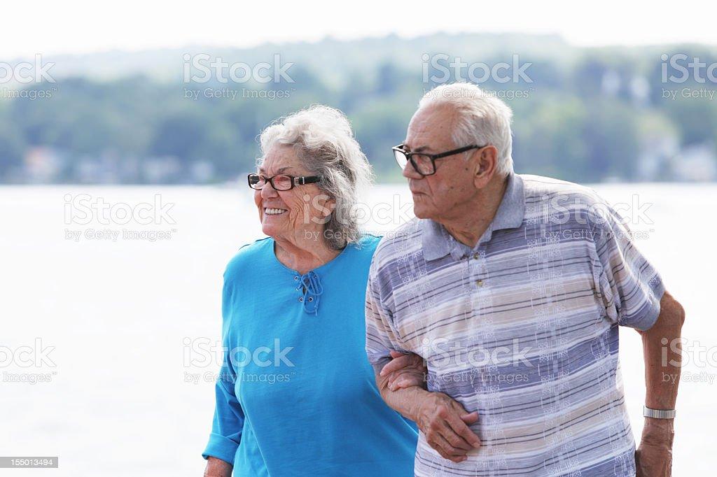 Senior Couple Walking Near the Lake royalty-free stock photo