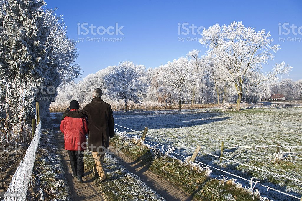 Senior couple walking on a winter day stock photo