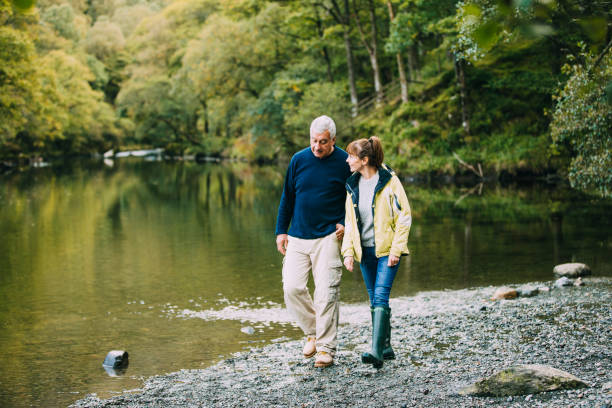 Senior Couple Walking round the Lake District stock photo