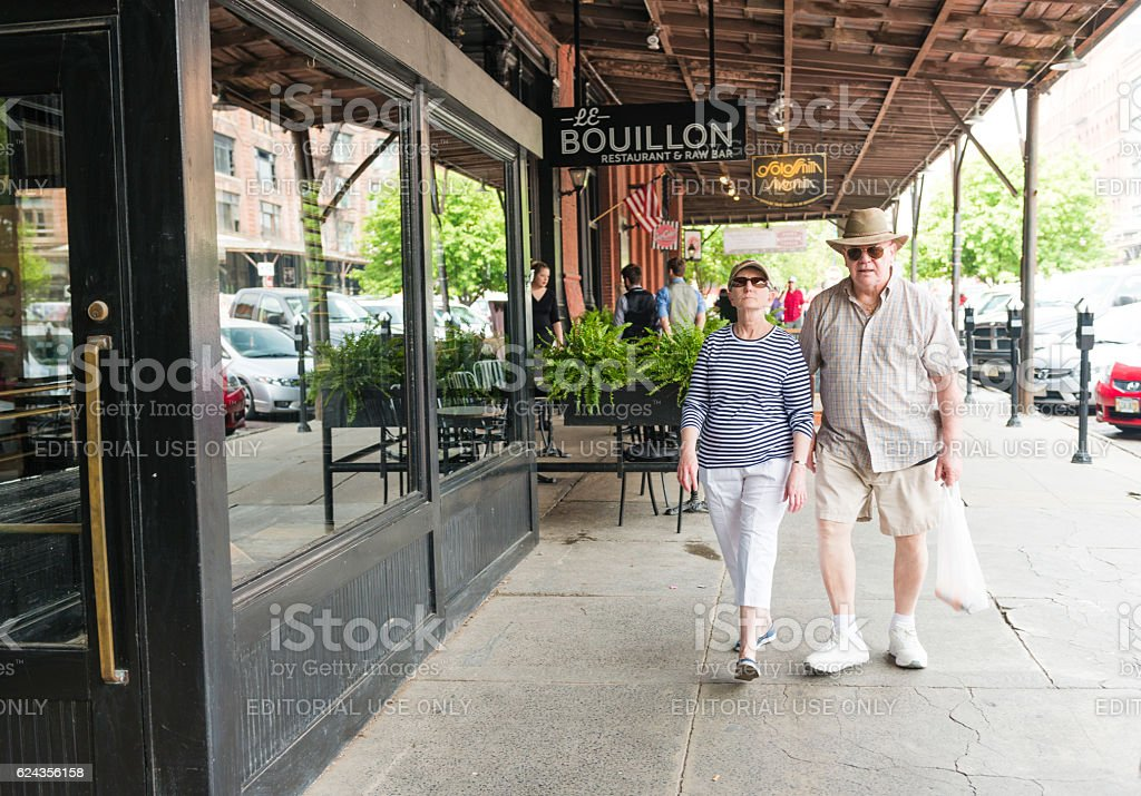 Senior Couple Walking Sidewalk of Downtown Old Market Omaha Nebraska stock photo