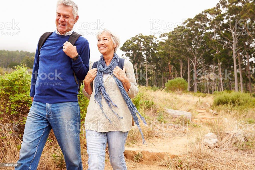 Senior couple walking together in a forest, close-up