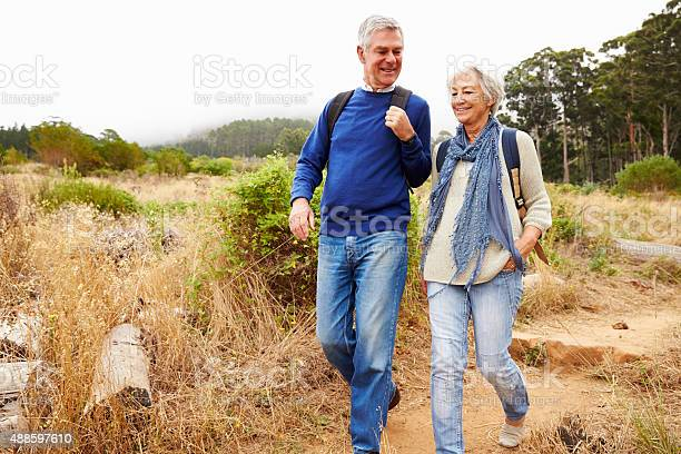 Senior couple walking together in a forest picture id488597610?b=1&k=6&m=488597610&s=612x612&h=tgwsxht4532ivvsi1amek9whk2k86st6gkoox03a7l4=