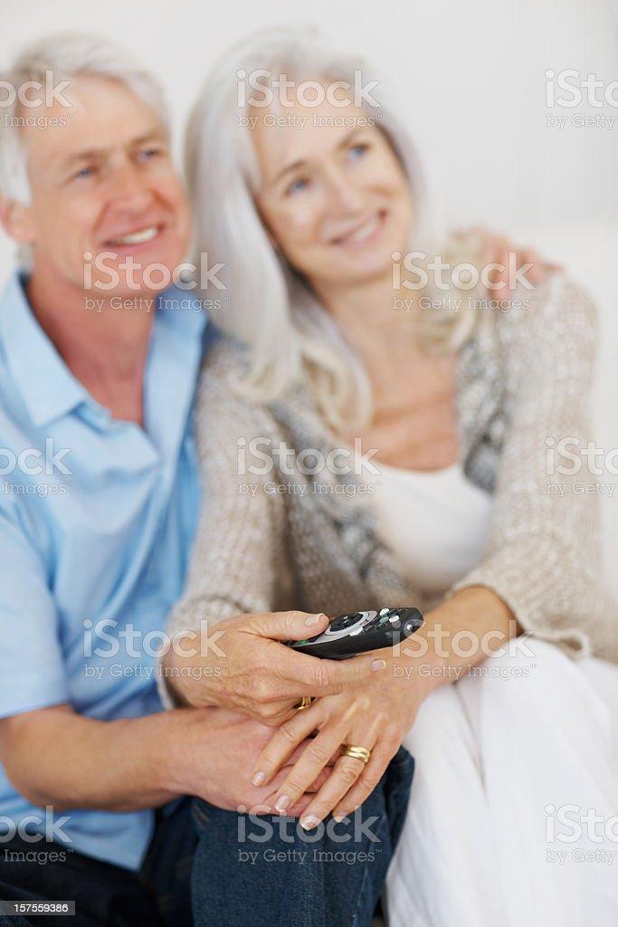 Senior couple watching television royalty-free stock photo