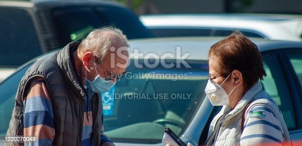 San Fernando Valley, CA, USA April 21, 2020 Senior couple wearing masks in a parking lot during the Corona Virus outbreak