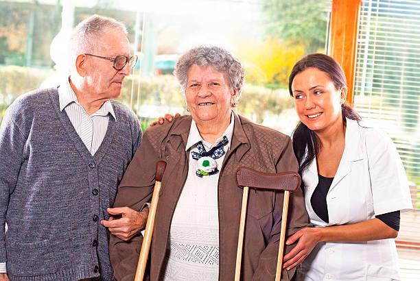 senior couple with a nurse stock photo