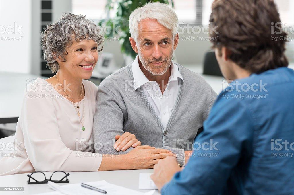 Senior couple with agent stock photo