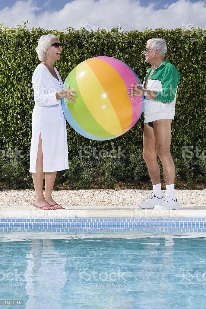 Senior couple with beachball 免版稅 stock photo