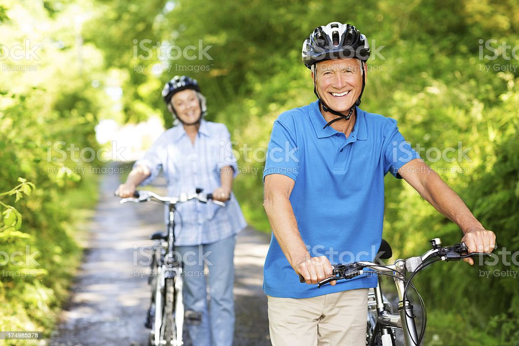 Senior Couple With Bicycles In Park. royalty-free stock photo