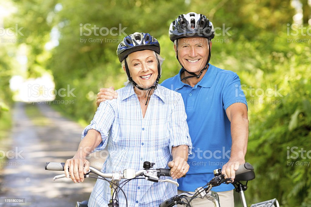 Senior Couple With Bicycles In Park royalty-free stock photo