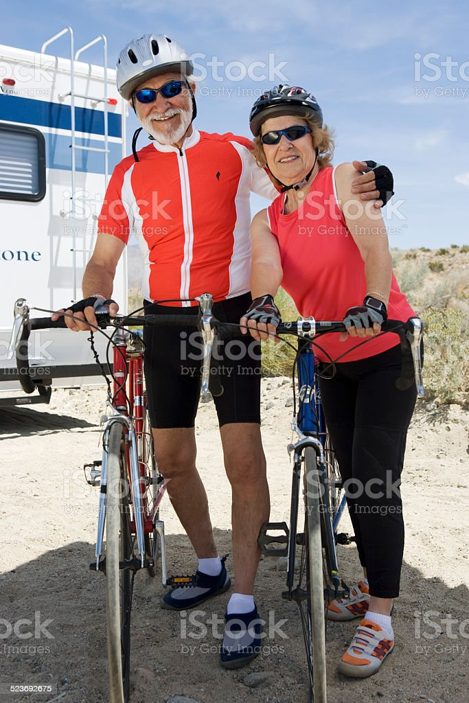 Senior couple with bikes royalty-free stock photo