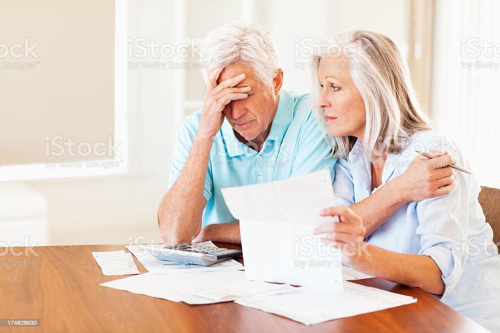 Senior Couple With Bills stock photo