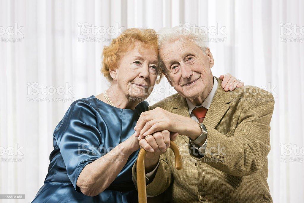 Senior couple with cane royalty-free stock photo