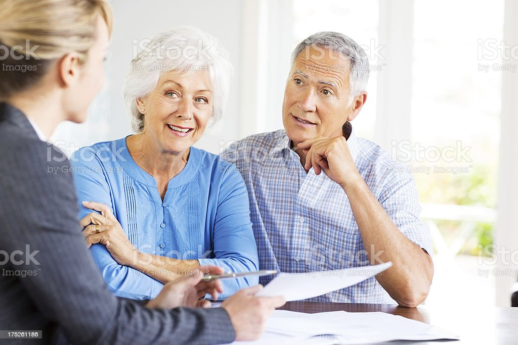 Senior Couple With Financial Advisor At Home. royalty-free stock photo
