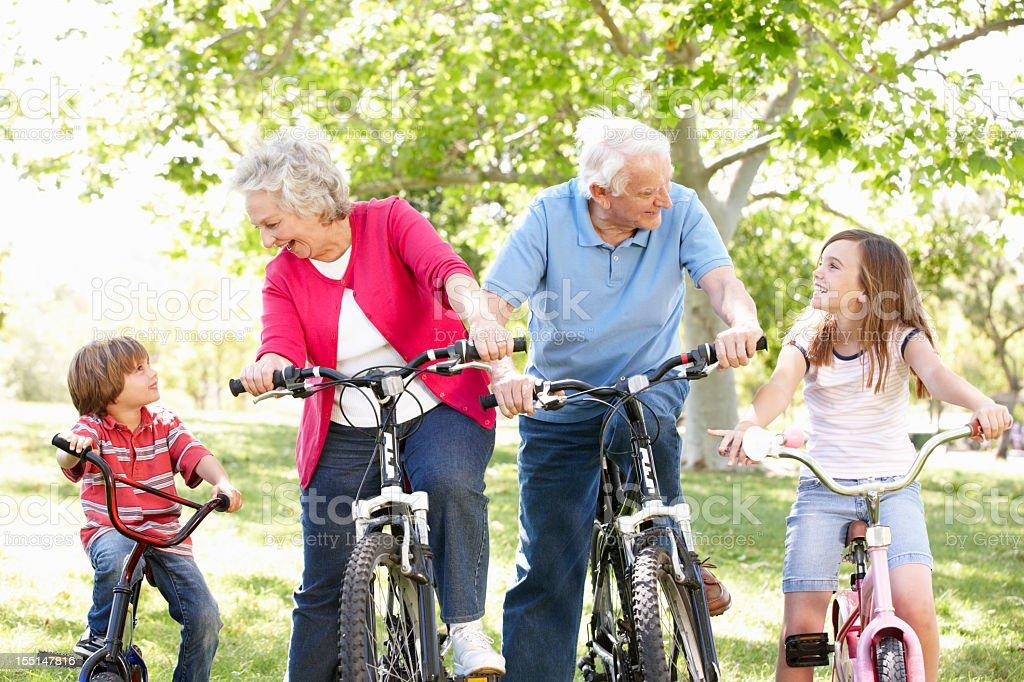 Senior couple with grandchildren on bikes royalty-free stock photo