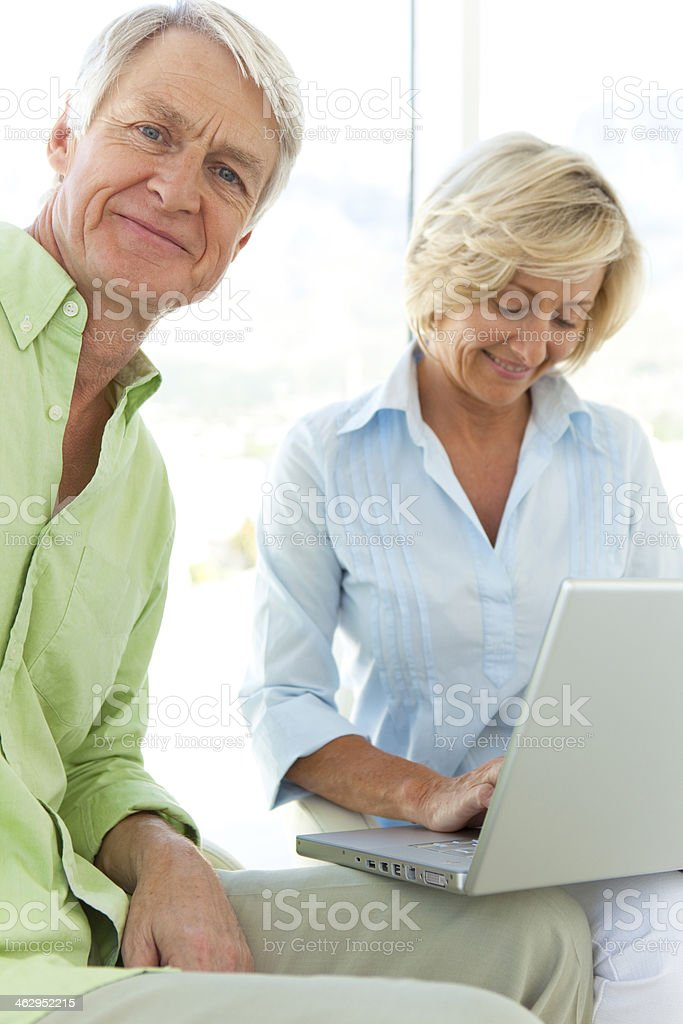 Senior couple with laptop royalty-free stock photo