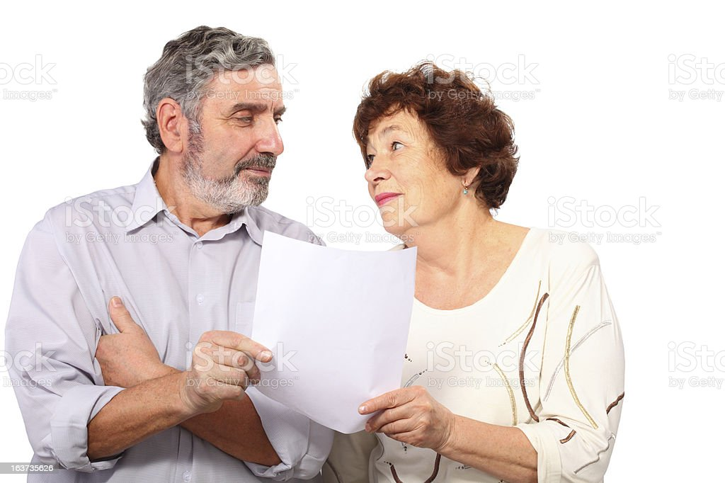 Senior couple with list of paper royalty-free stock photo