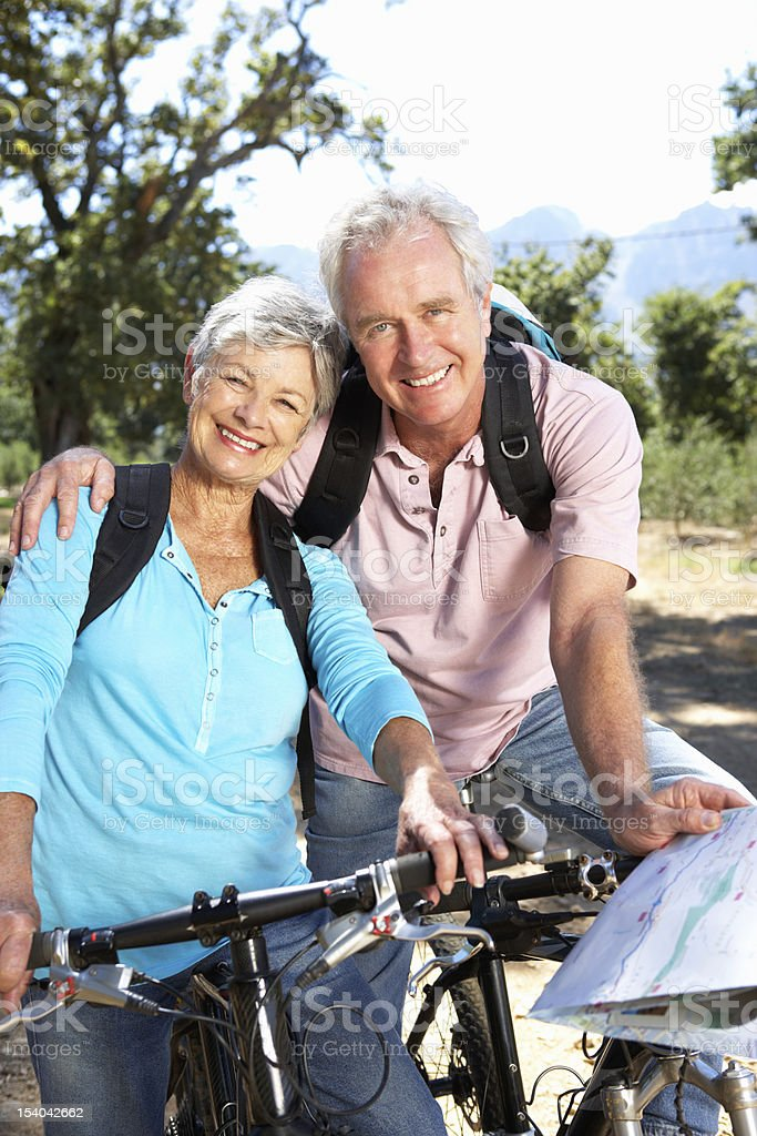Senior couple with map on country bike ride royalty-free stock photo