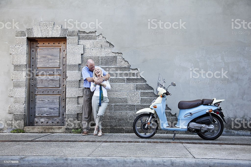Senior couple with motor scooter royalty-free stock photo