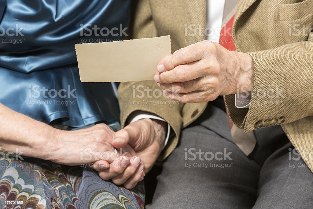 Senior couple with old photo royalty-free stock photo