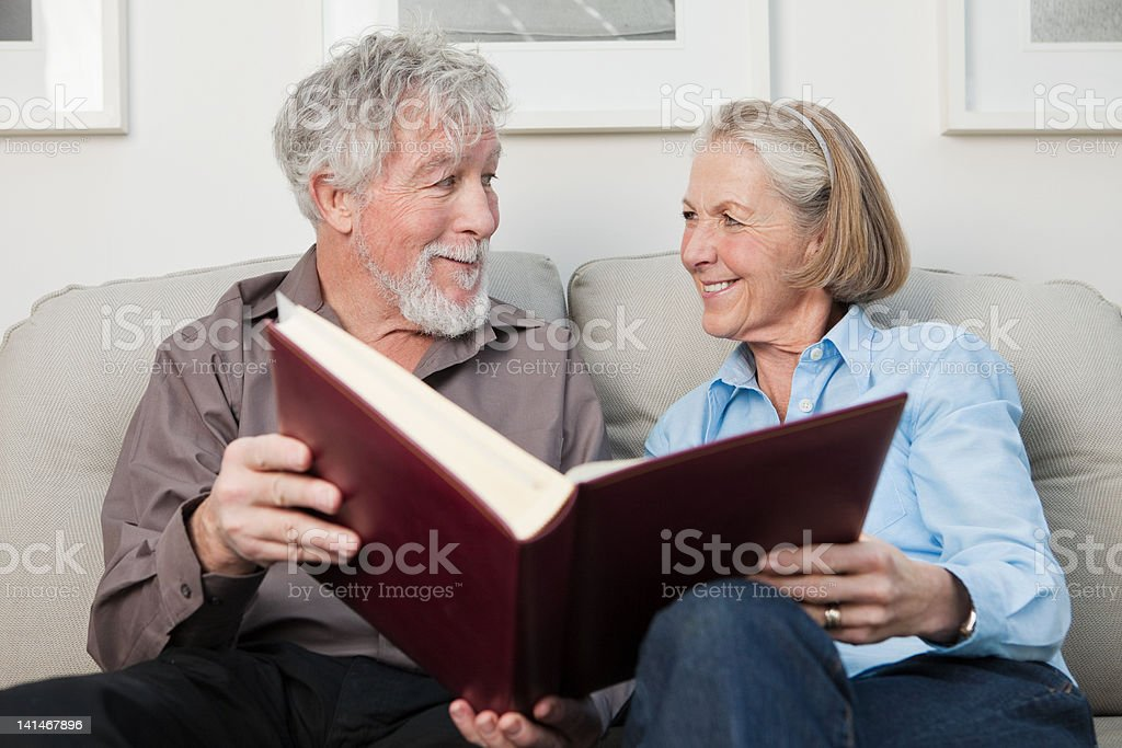 Senior couple with photograph album stock photo