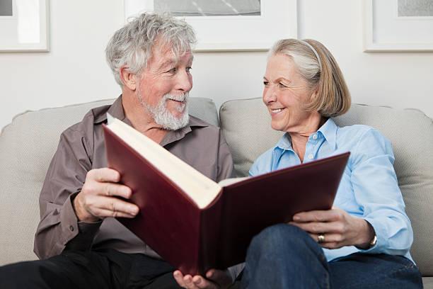 Senior couple with photograph album stock photo