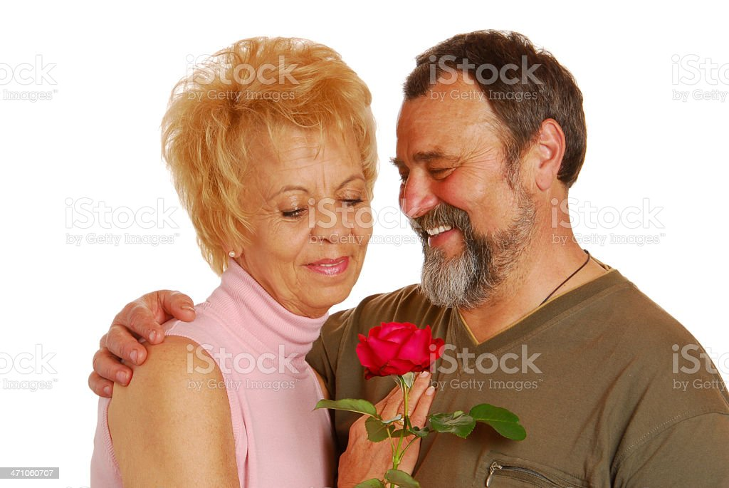 Senior couple with red rose royalty-free stock photo
