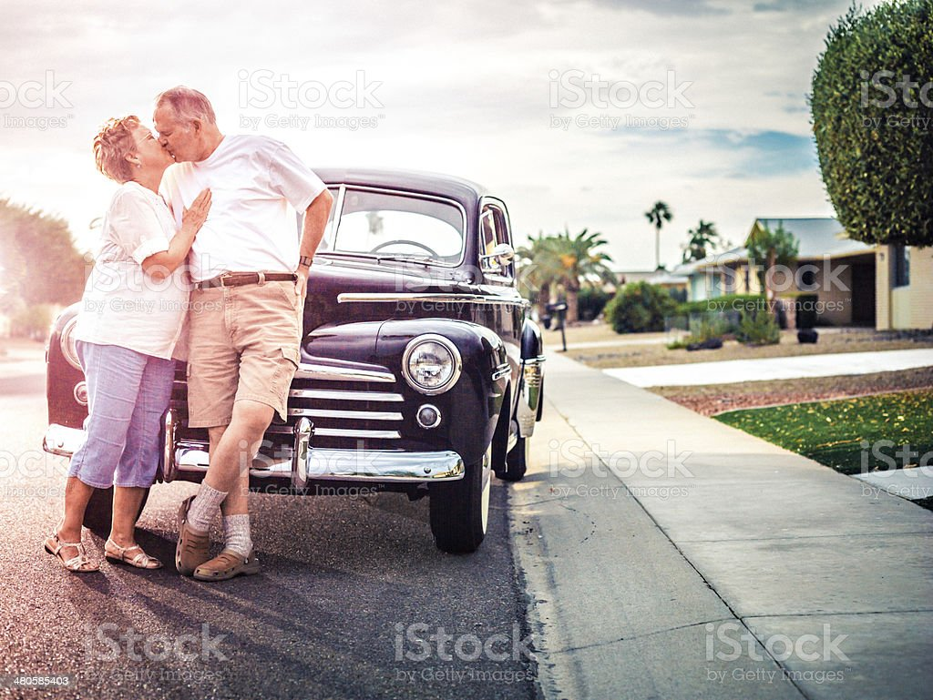 Senior couple with retro car stock photo