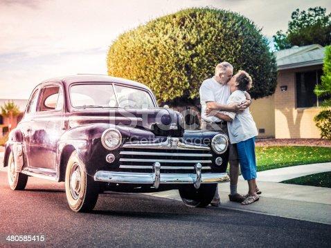 Senior couple with retro car