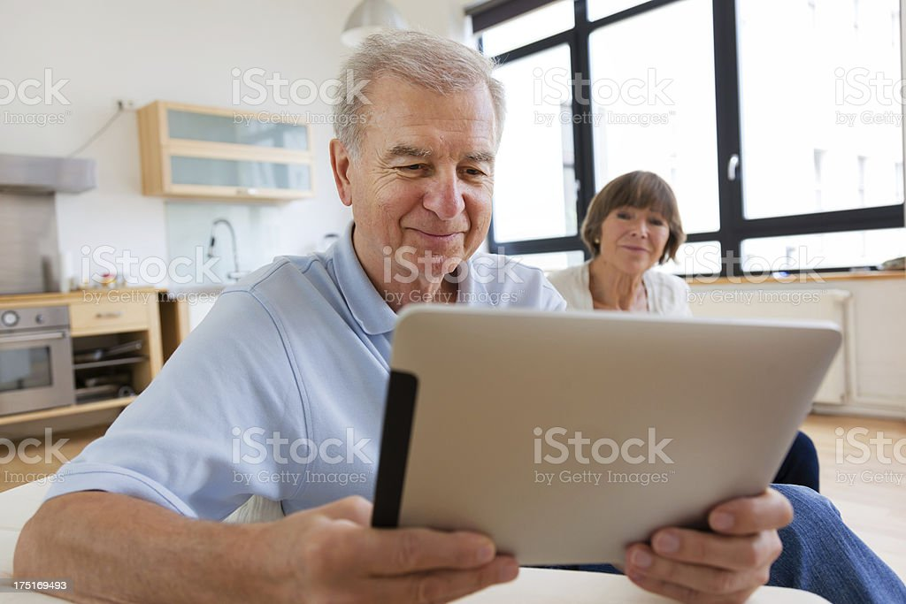 Senior couple with tablet computer stock photo