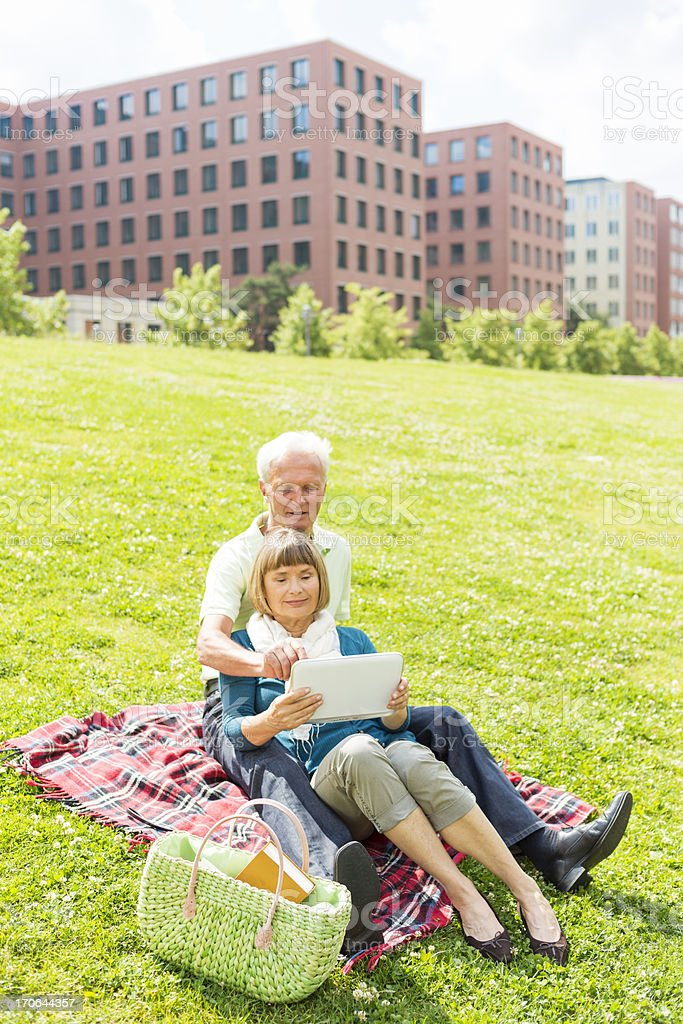 Senior couple with tablet royalty-free stock photo