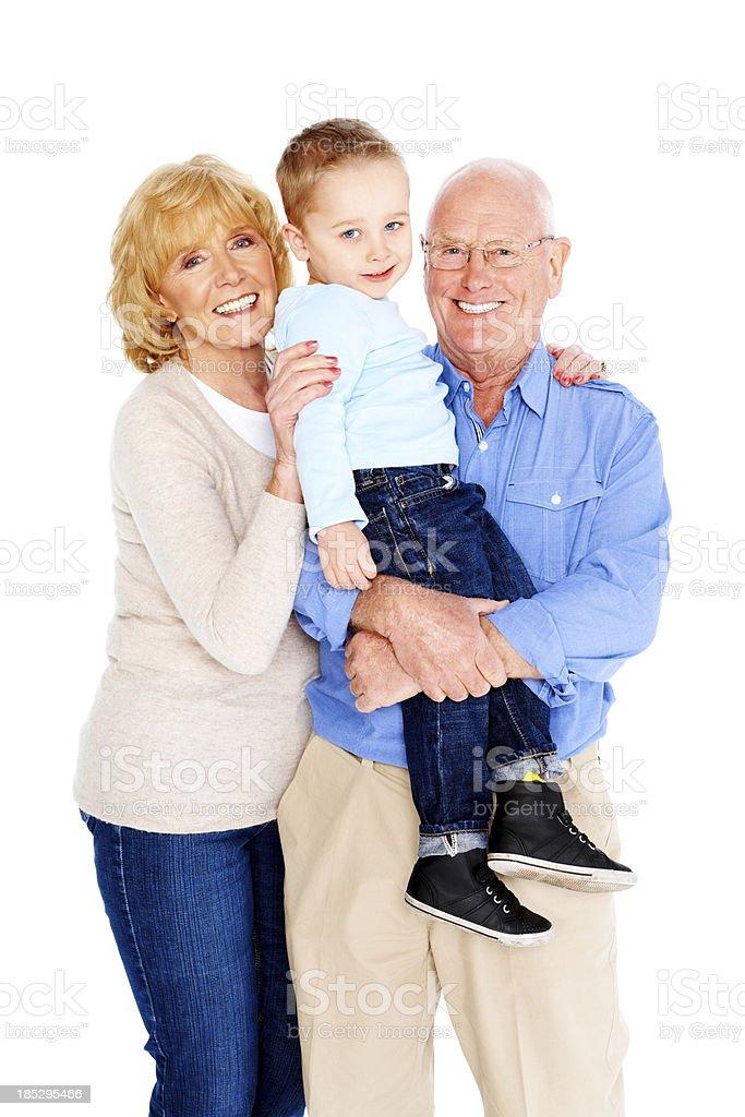 Senior couple with their grandson on white royalty-free stock photo