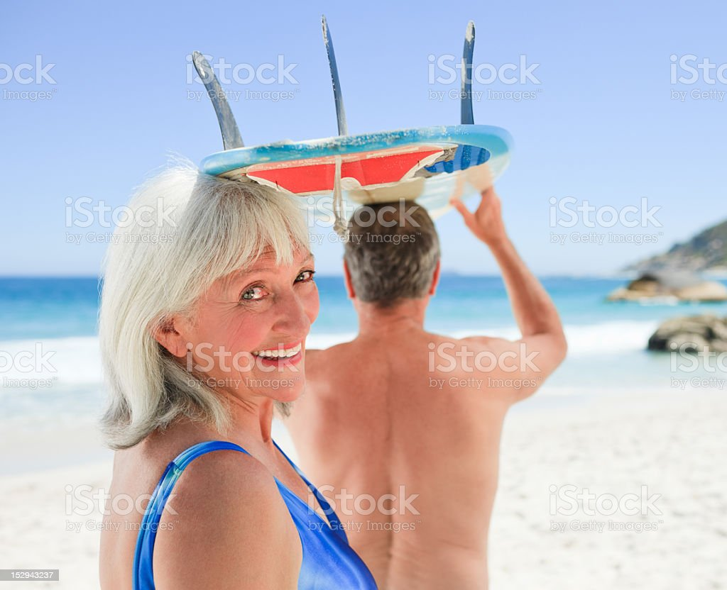 Senior couple with their surfboard royalty-free stock photo