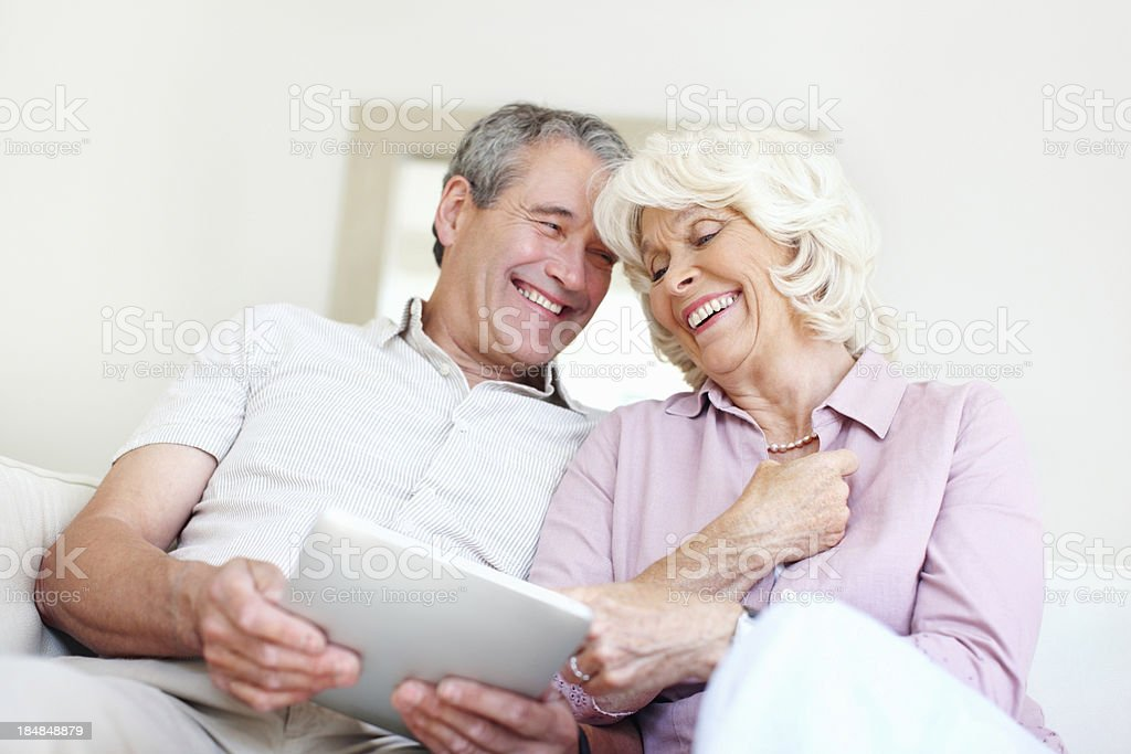 Senior couple with their tablet computer royalty-free stock photo