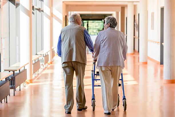 Senior couple with walking frame stock photo