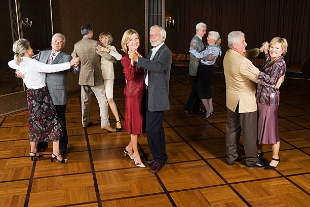Senior couples dancing stock photo